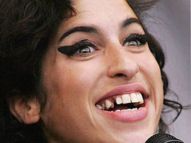 Amy Winehouse hospitalized after fainting in London home
