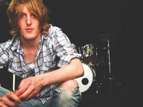 Razorlight drummer Andy Burrows auctions drum kit for charity