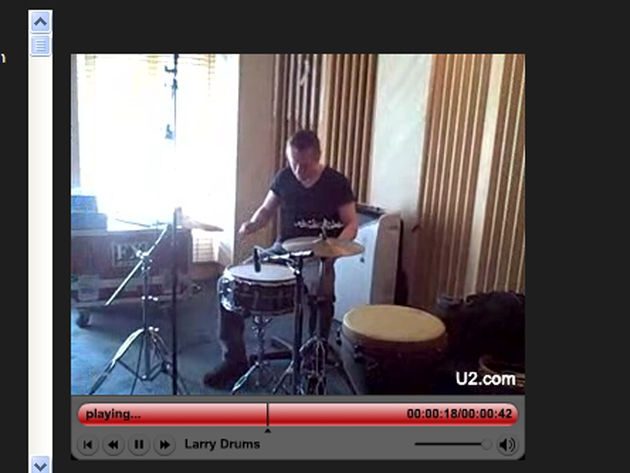 Larry Mullen on drums. Like, wow!