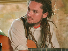Modern acoustic guitar with John Butler