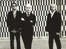 R.E.M. joined onstage by first producers
