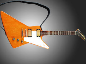 The Edge auctions his Gibson Explorer for charity