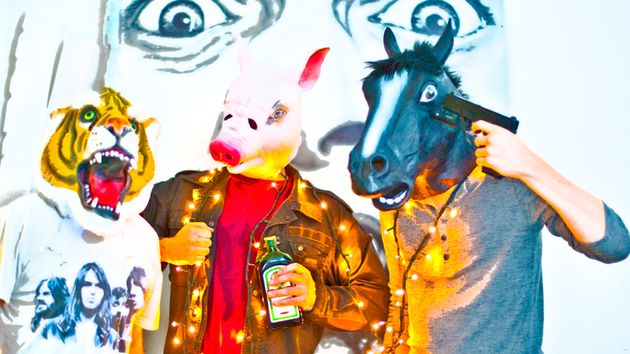 A tiger, a pig and a horse walk in to a bar...
