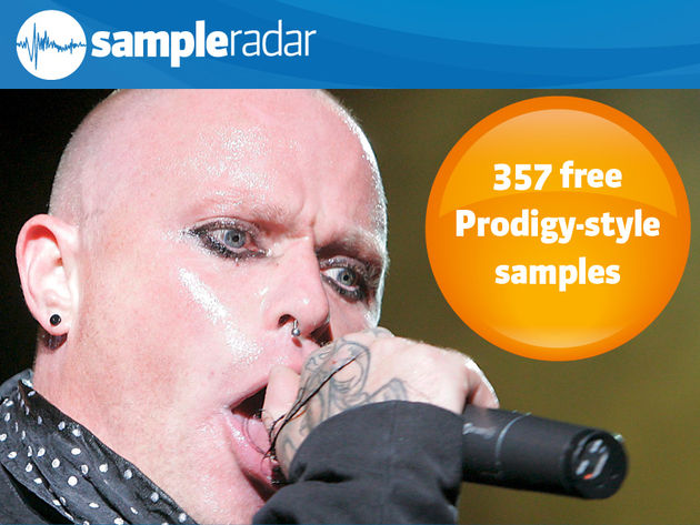 Keith Flint attempts to eat his microphone.