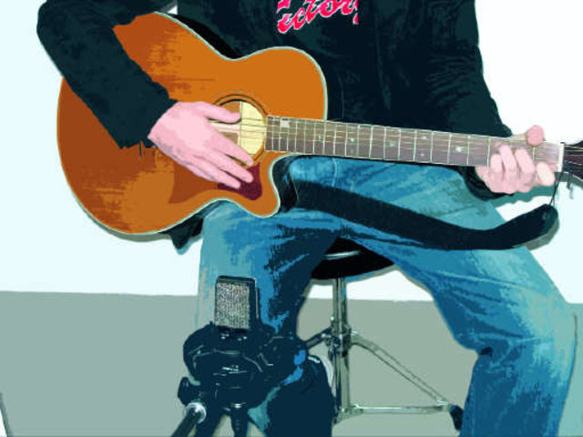 Point your mic at the point where the guitar's neck and body meet.