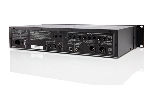 The rear-panel features Midi In, Out and Thru; eight jack outputs; two XLR outs; digital output and two audio inputs