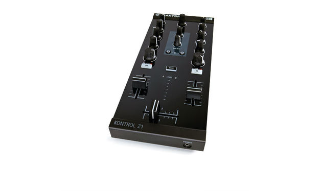 The layout is that of a traditional two-channel DJ mixer, complete with a built-in audio interface for monitoring