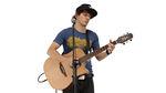 Jouer de la guitare acoustique sur scène