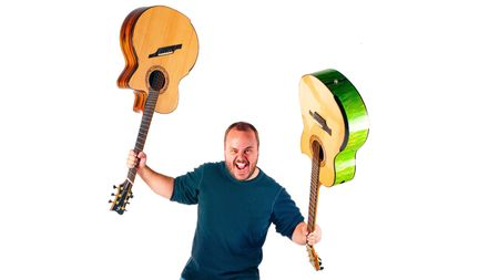 Andy McKee talks tapping and harp guitars