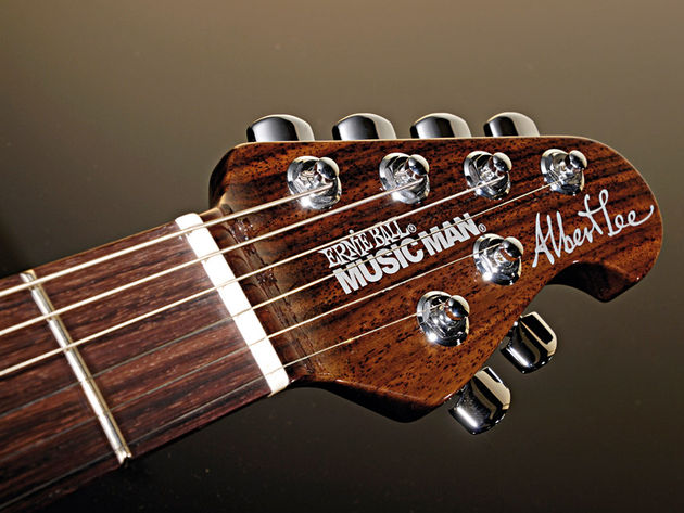 The rosewood headstock sports Music Man's 'four and two' tuner arrangement