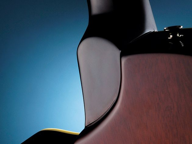 A sculpted heel aids top-fret access.