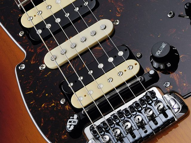 The bridge and hex pickups don't look too incongruous on an ordinary guitar.