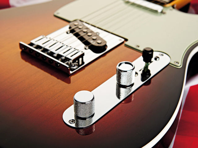 The white edge-binding gives the American Deluxe a '60s Tele Custom look.