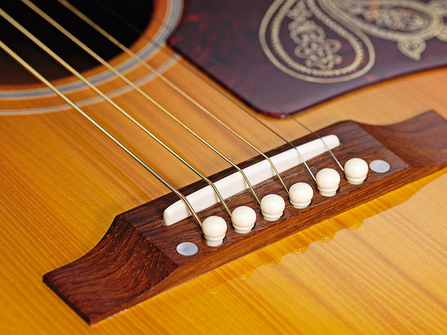 Highly prized Adirondack Red spruce is used for the guitar's top.