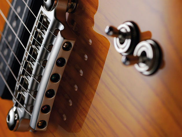 Each pickup has it's own three-way mode switch: clean, crunch and dirty.