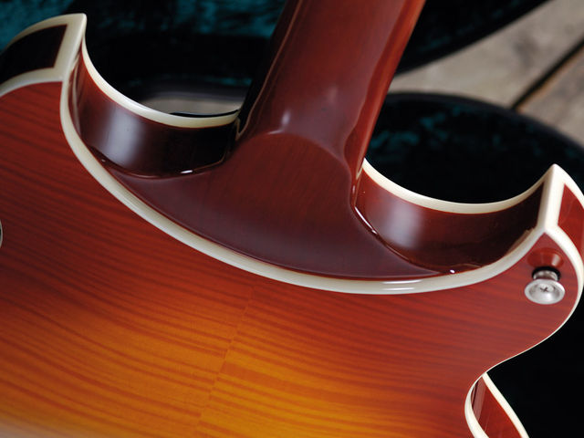 The heel is in fact an extension of the body's mahogany centre section.