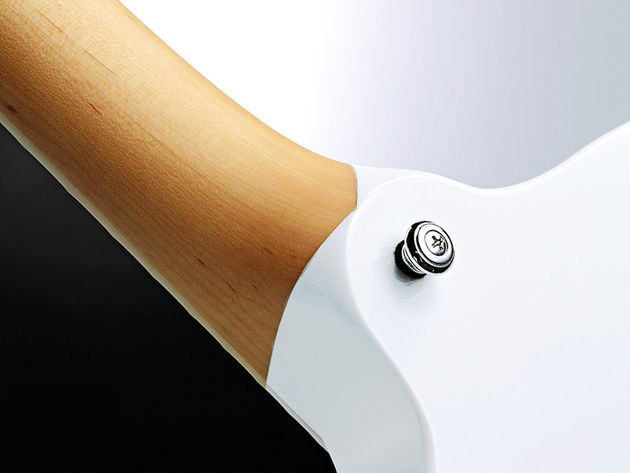 A three-piece strip of maple makes up the neck, headstock and body core.