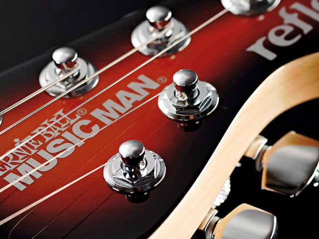 The familiar Music Man tuner arrangement allows straight string travel.