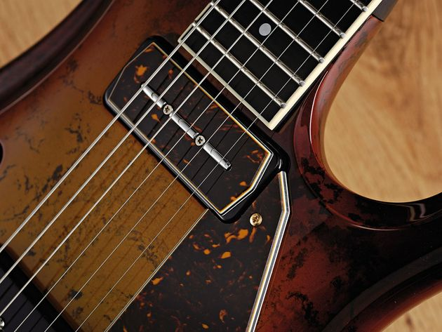 The Flaxwood's dappled brown sunburst gives it a  unique look.