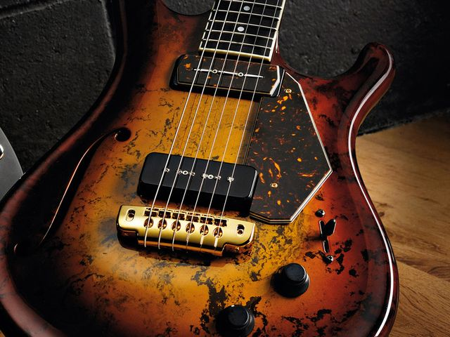 The Flaxwood CC-H CC Custom's body and neck are both constructed out of, well... Flaxwood.
