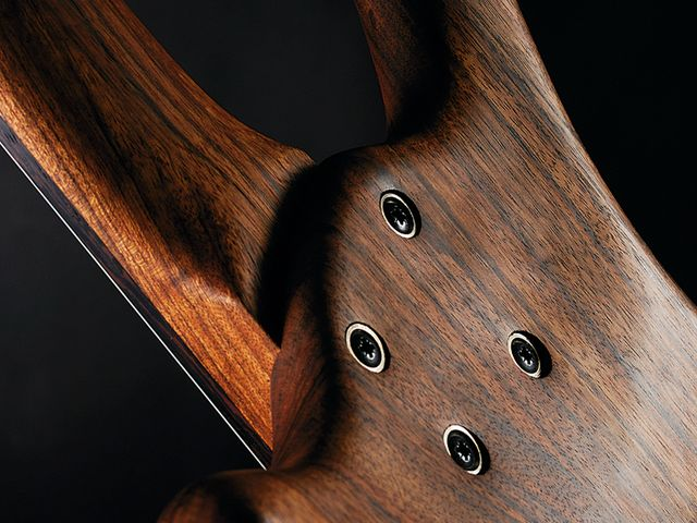 The back is concaved where body and neck meet to aid upper fret access.