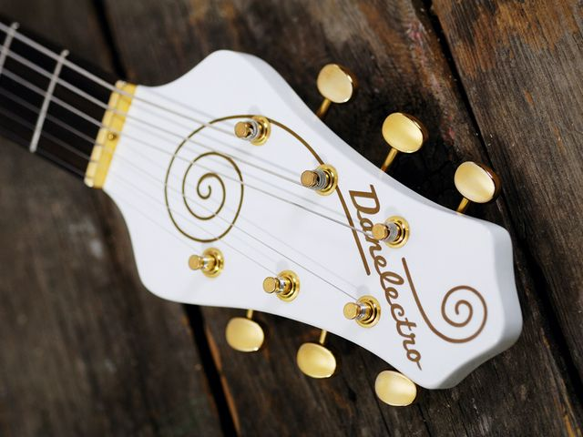 The Single Cutaway's oversized headstock sets it apart.