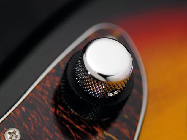 The Jag's chrome knob controls volume.