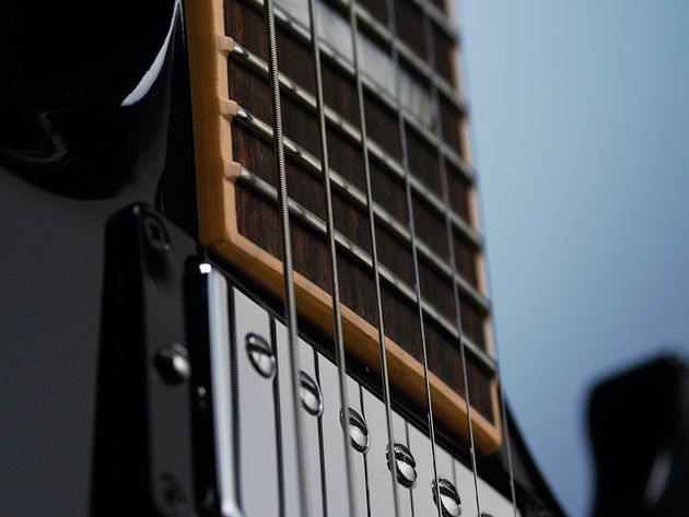 The extra frets don't add anything to the SG's neck, only the fingerboard.