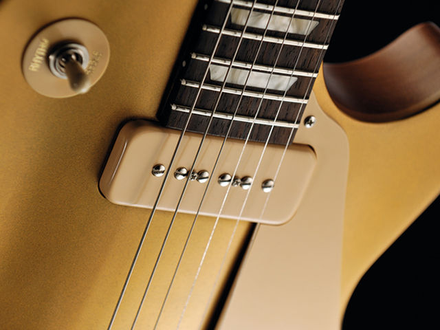 The worn gold of the Gibson suits its workhorse vibe.