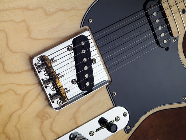 The Wilkinson WTB bridge features compensated brass saddles to improve intonation.