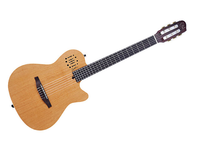 The guitar's top is solid cedar.