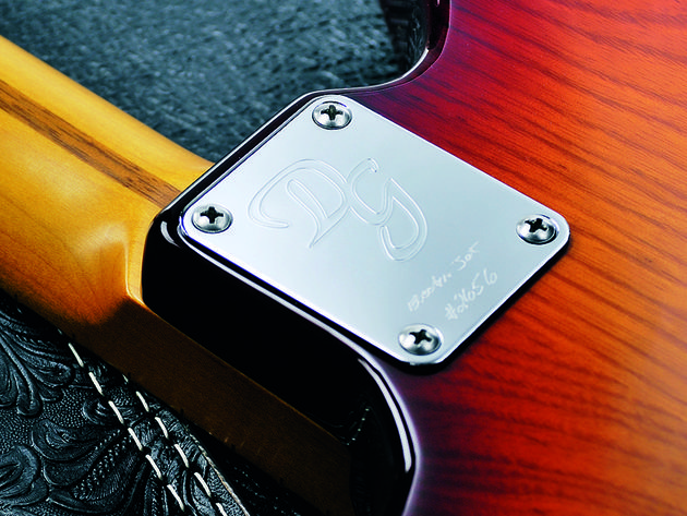 The four-bolt neck and chrome plate are very Fender-inspired.