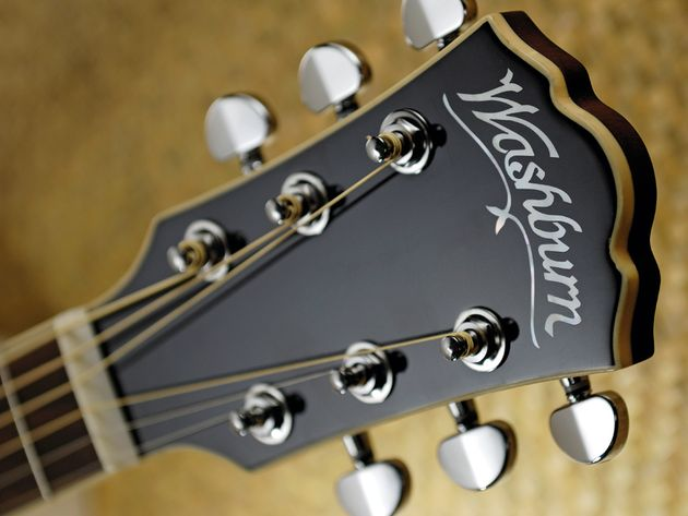 There's some evidence of retro-filling where the Washburn's headstock angles away from the neck.