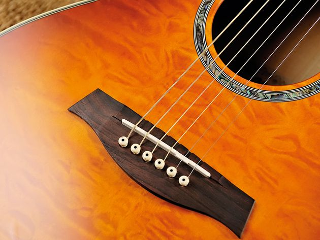 An understated soundhole rosette complements the A300's distinctive finish.