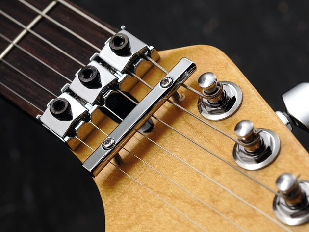 Something about a double-locking vibrato on a silver Strat just works…