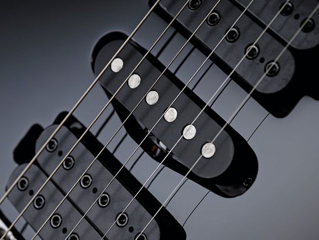 The DiMarzio pickups are replaced with Ibanez CAP-VM units.