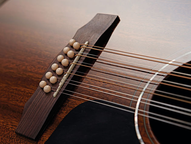 The finish on the D-125-12 shows off the lustrous grain of the mahogany top.