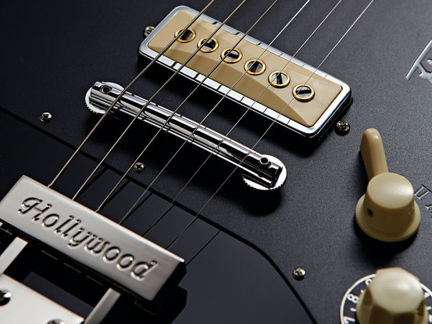 The vintage-correct bridge is a nice touch, but could cause intonation issues.