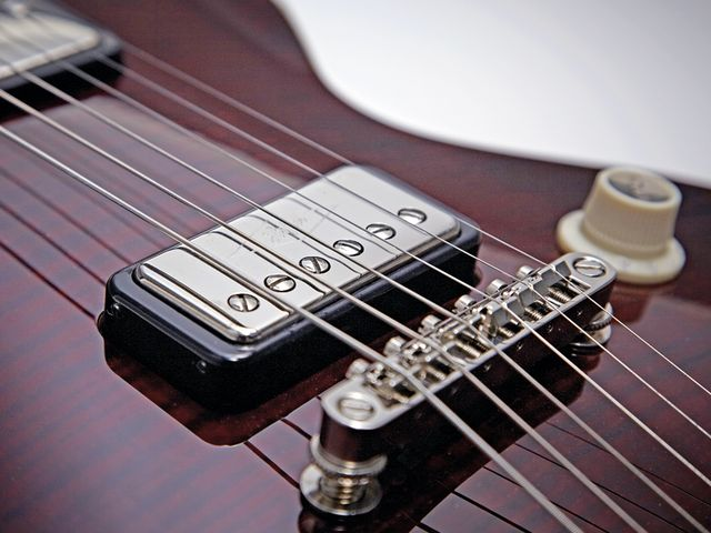 The Solid's tune-o-matic-style bridge is married to a trapeze tailpiece.
