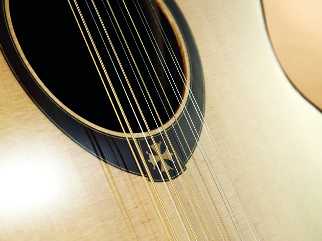 The 12-string T400J12CE boasts a warm tone both acoustically and plugged in.