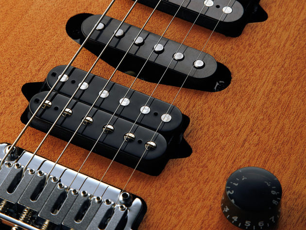The Suhr-made pickups are screwed directly into the mahogany body.