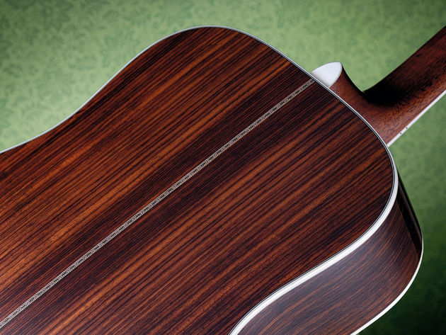 …while the back and sides are laminated Indian rosewood.
