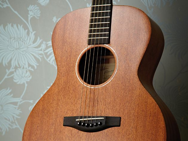 The Atkin AA AM Special's narrow pearl soundhole ring tops off a subtle aesthetic approach.
