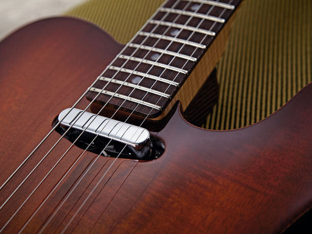 The Carved Koa Top Telecaster's neck pickup is a hot and bright variation.