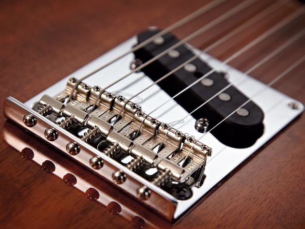 The Tele bridge has bent Strat saddles.