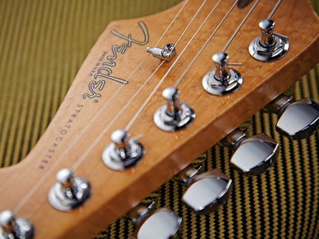 The Select Strat HSS's stagger-height tuners are locking.