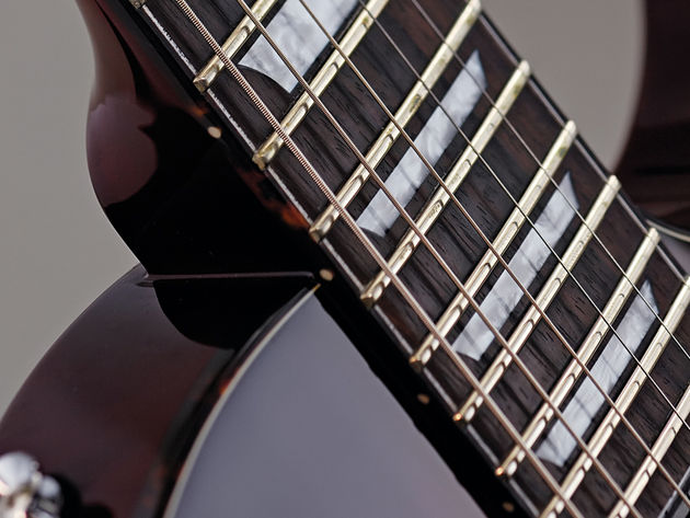 The Eclat Standard's medium jumbo frets are finely dressed.