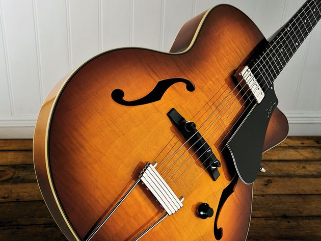 The Godin 5th Avenue Jazz is available faced with flame maple or in an all-black version.