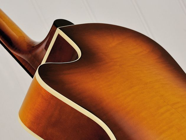 Tidy binding and a beautiful 'burst adorn the guitar's 14th-fret join.