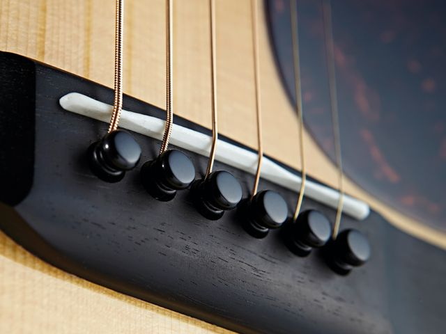 The D-18 comes finished with all-black bridge pins.